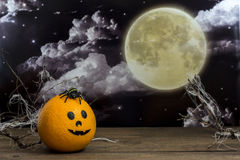 Halloween. Orange with a muzzle on the table Halloween Stock Photo