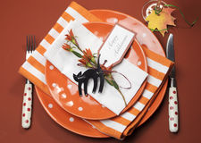 Halloween orange polka dot and stripes dinner table setting. Aerial view. Stock Photo