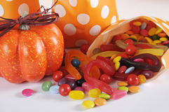 Halloween orange polka dot trick or treat paper bags with multi-color candy closeup. Stock Images
