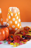 Halloween orange polka dot trick or treat paper bags with multi-color candy - vertical. Stock Image
