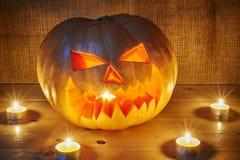 Halloween orange pumpkin jack lantern with candles Stock Photography