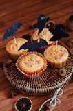 Halloween orange sprinkled cupcakes with pumpkin cream and ghost. Halloween orange sprinkled cupcakes with pumpkin cheese cream and scary ghost and bat stock photography