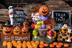 Halloween ornament party with orange candy and trick or treat Stock Photos