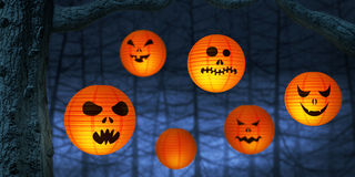 Halloween paper lanterns in a dark and spooky forest Stock Images