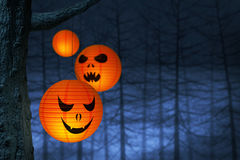 Halloween paper lanterns in a dark and spooky forest Royalty Free Stock Photos