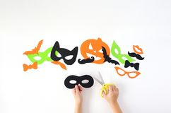 Halloween. The paper masks on a white background which are cut out from paper stock photo