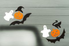 Halloween paper silhouette of different characters. Top view of Halloween paper silhouette of different characters made of horizontal frame on grey wooden Stock Images