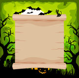Halloween parchment sign on background green Stock Image