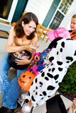 Halloween: Parent Handing Out Candy on Halloween Stock Photo