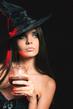 Halloween party 2016! Beautiful woman like witch holding cocktail Stock Photo