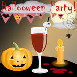Halloween party. Bloody cocktail, pumpkin, candle and other traditional attributes Royalty Free Stock Photos