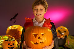 Halloween party with a boy child holding pumpkin Royalty Free Stock Image