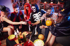Halloween party. Cheers at the halloween party Royalty Free Stock Image