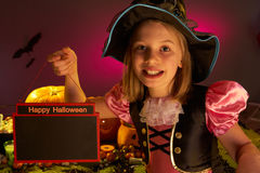 Halloween party with a child holding sign in hand Stock Images