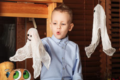 Halloween party with child holding toy ghost Royalty Free Stock Image