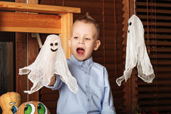 Halloween party with child holding toy ghost. Royalty Free Stock Images