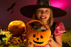 Halloween party with a child showing candy. Smiling Royalty Free Stock Photo