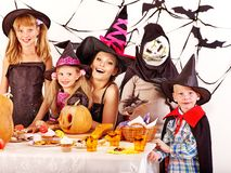 Halloween party with children. Halloween party with children holding carving pumkin Stock Image