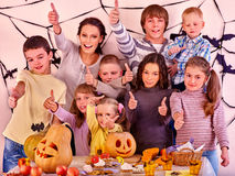 Halloween party with children holding trick or Stock Image
