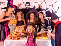 Halloween party with children holding trick or Stock Photo