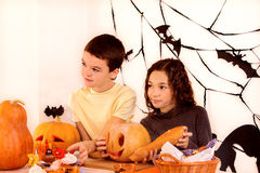 Halloween party with children holding trick or Royalty Free Stock Photos