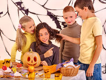 Halloween party with children holding trick or Royalty Free Stock Photo