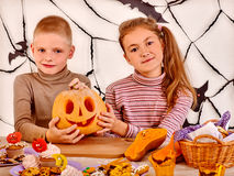 Halloween party with children holding trick or Stock Images