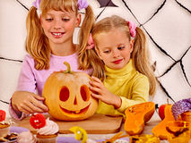 Halloween party with children holding trick or Royalty Free Stock Images