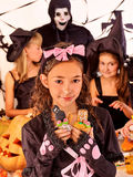 Halloween party with children holding trick or Stock Photos