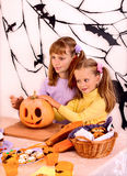 Halloween party with children holding trick or Royalty Free Stock Image