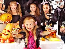 Halloween party with children holding trick or treat. Stock Photo