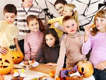 Halloween party with children holding trick or treat. Royalty Free Stock Photo