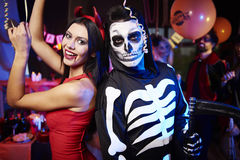 Halloween party. Creepy couple on the night party Stock Photos