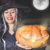 Halloween party 2016! Fashion asian woman like witch holding pumpkin Royalty Free Stock Photo