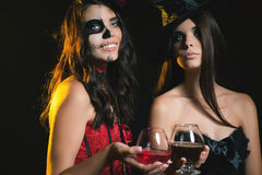 Halloween party 2016! Fashion women like witch holding cocktail Royalty Free Stock Photos