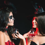 Halloween party 2016! Fashion women like witch holding cocktail. Of blood. Makeup. Halloween costumes. Role. Witch carnival costume Royalty Free Stock Images