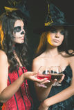 Halloween party 2016! Fashion women like witch holding cocktail. Of blood. Scary makeup. Hallowen costumes. Role. Witch carnival costume Stock Image