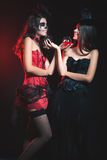 Halloween party 2016! Fashion women like witch holding cocktail Royalty Free Stock Photography