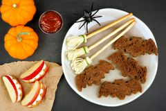 Halloween party food with bat breads, broomsticks and apple teeth Royalty Free Stock Image