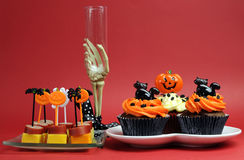 Halloween party food with skeleton hand glass on red background. Royalty Free Stock Image