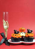 Halloween party food with skeleton hand glass on red background - vertical with copyspace. Royalty Free Stock Images