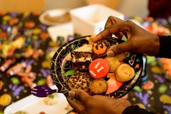 Halloween Party Food. Woman serving desserts at a Halloween party on plate with cookies cupcake and spooky Halloween treats Stock Images