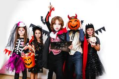 Halloween party. Funny kids in carnival costumes on white background Royalty Free Stock Photo