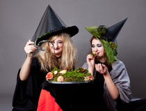 Halloween party - girls in costumes of witches Royalty Free Stock Photos