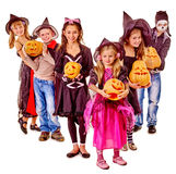 Halloween party with group kid holding carving Stock Photos
