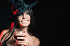 Halloween party. Halloween costumes. Halloween party. Beautiful woman like witch holding cocktail of blood. Halloween costumes. Role. Witch carnival costume Royalty Free Stock Image