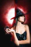 Halloween party. Halloween costumes. Halloween party. Beautiful woman like witch holding cocktail of blood. Halloween costumes. Role. Witch carnival costume Royalty Free Stock Photo