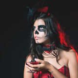 Halloween party 2016! Halloween costumes and makeup. Halloween party 2016! Beautiful woman like witch holding cocktail of blood. Halloween costumes and makeup Stock Images