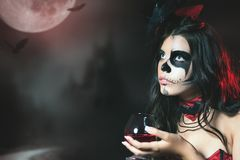 Halloween party 2017 Halloween costumes and makeup. Halloween party 2017 Beautiful woman like witch holding cocktail of blood. Halloween costumes and makeup Royalty Free Stock Photo