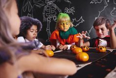 Halloween party for kids. You have to think as hard as can Stock Images